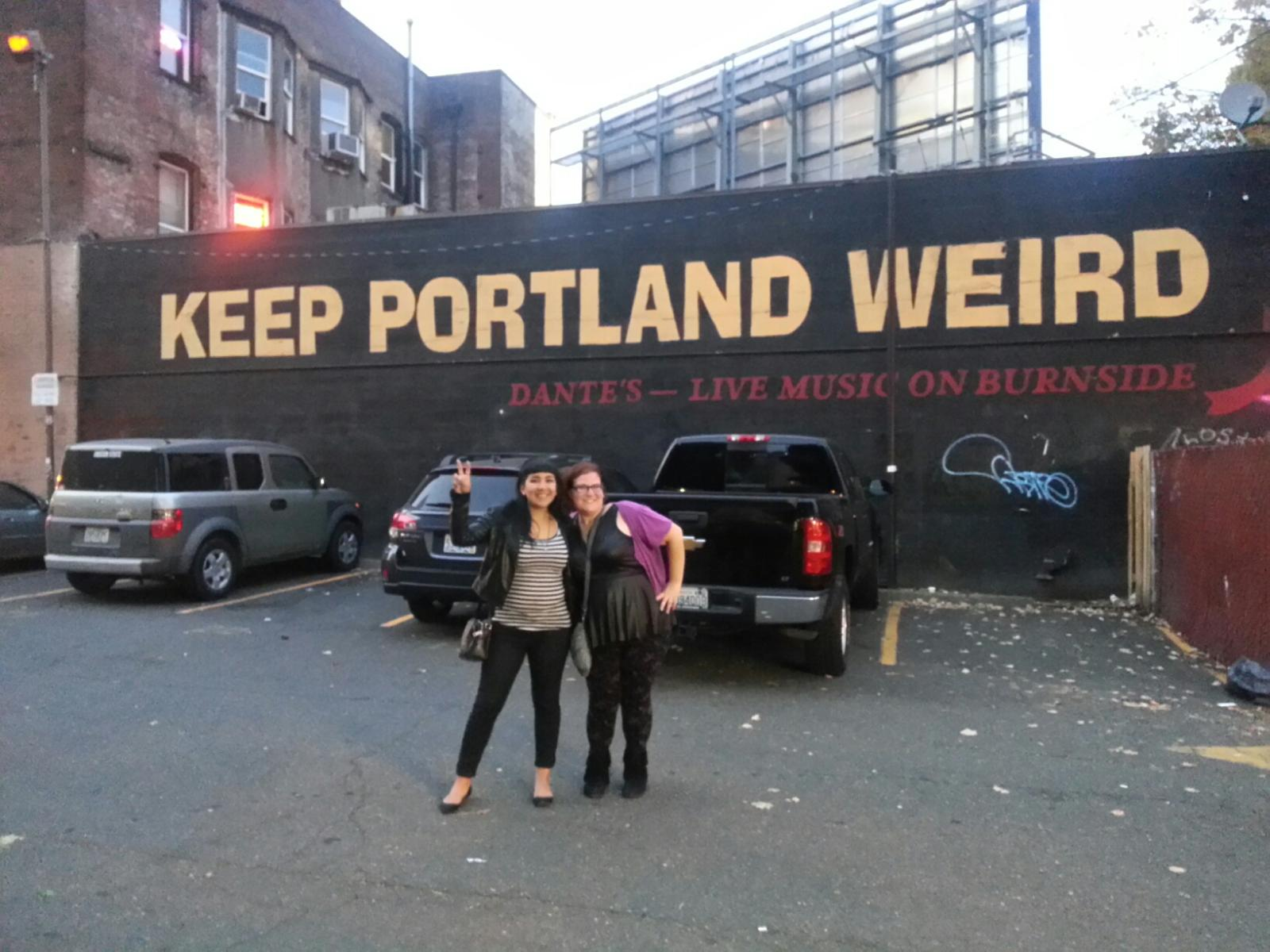 Corina and me in front of the infamous wall on the back of Dante's.