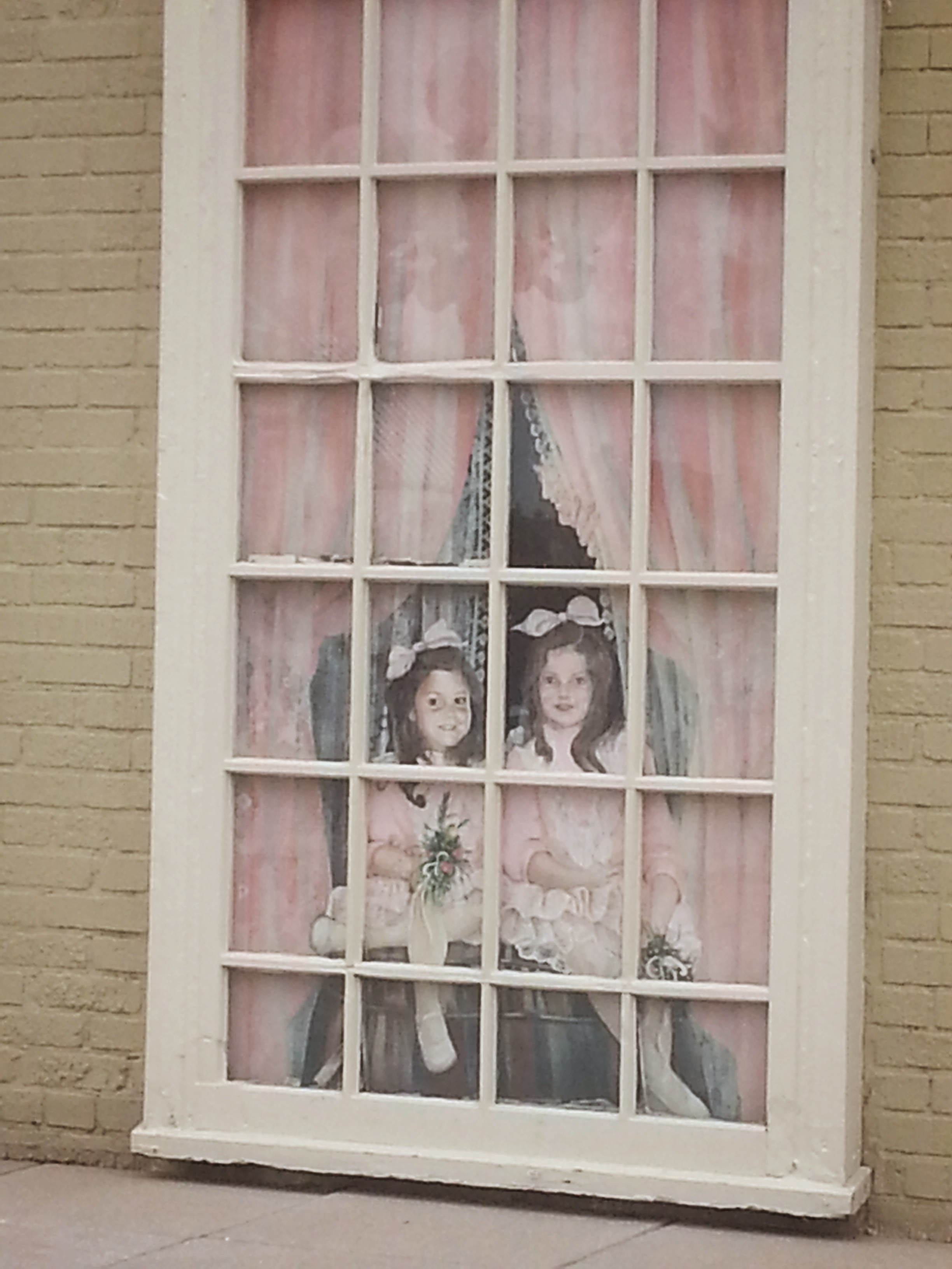 Creepy cardboard girls in the window of the duck penthouse!