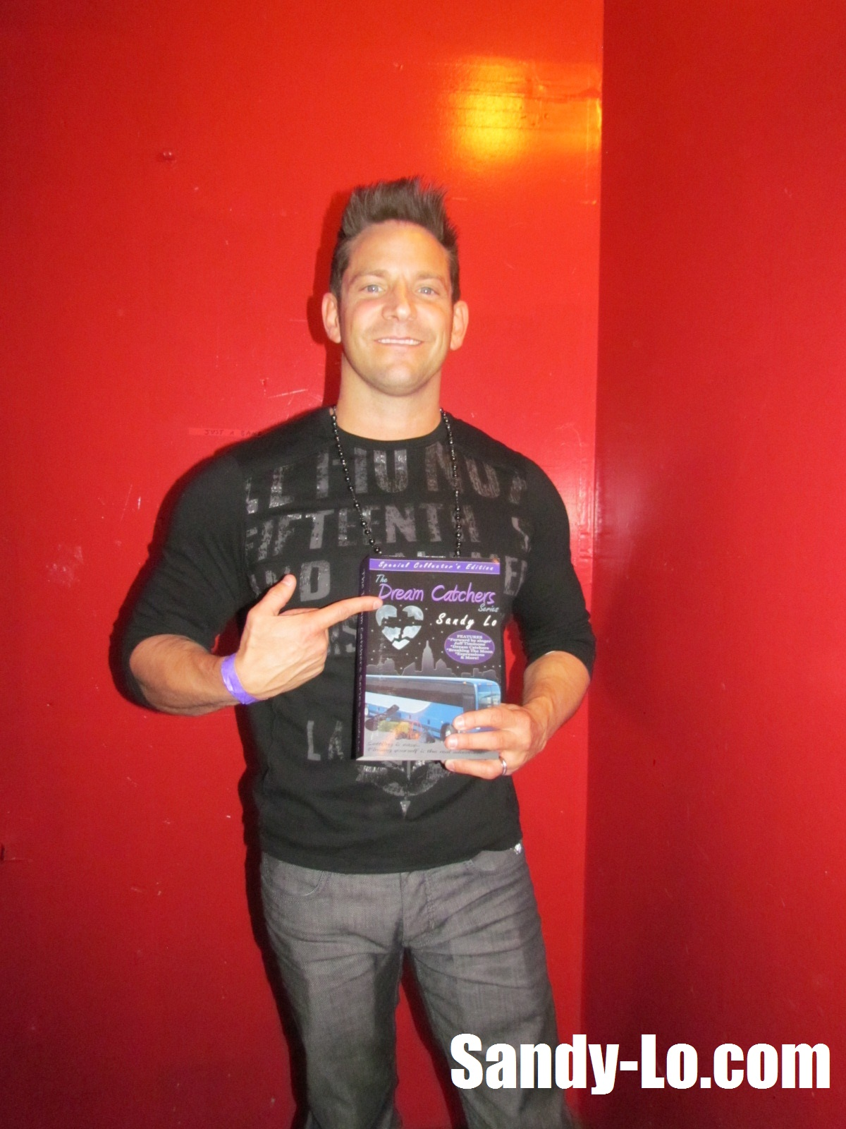 "Jeff Timmons of 98 Degrees with his personal copy of the ""Dream Catchers"" Series collector's edition, which I autographed of course!"
