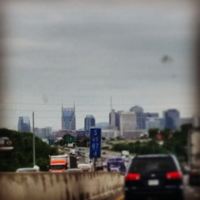 Nashville skyline from the car on a cloudy day.