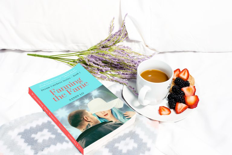 Fanning the Fame Paperback Flatlay